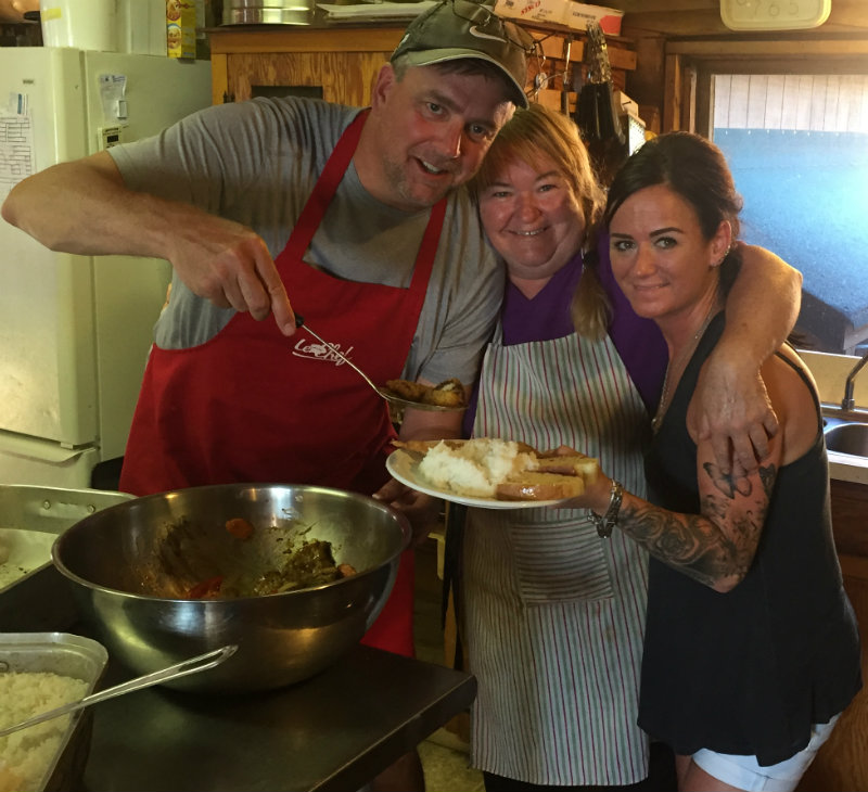 Tony Padgett Artist with Denise, cook, and Renee, Camp Manager